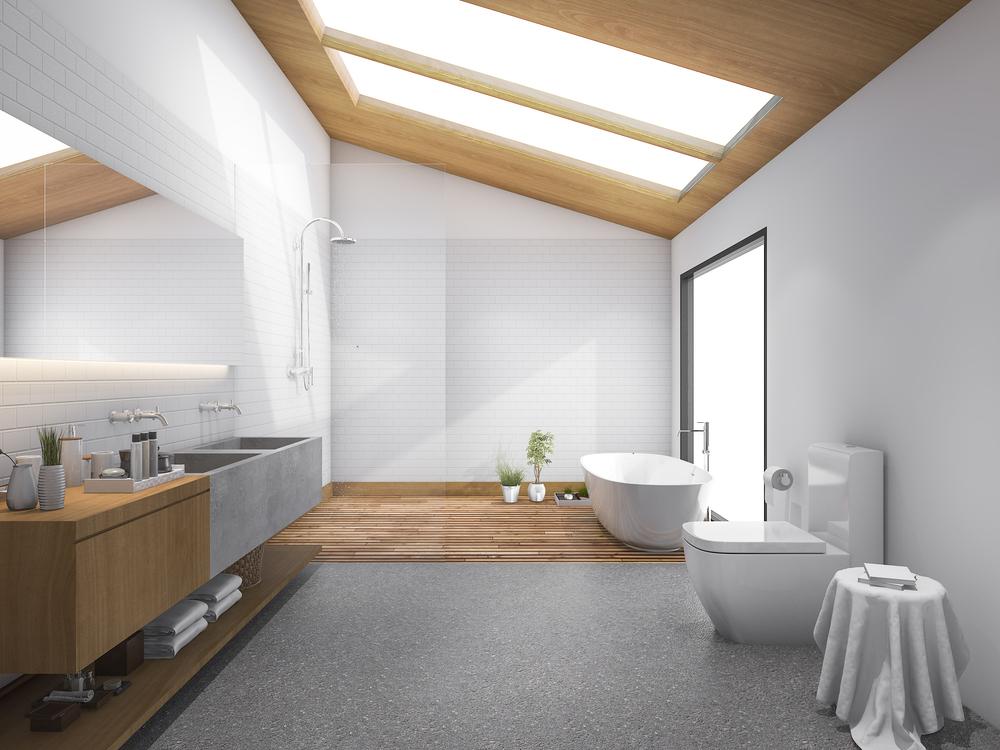 Grandes fenêtres de toit dans des combles aménagés en salle de bain