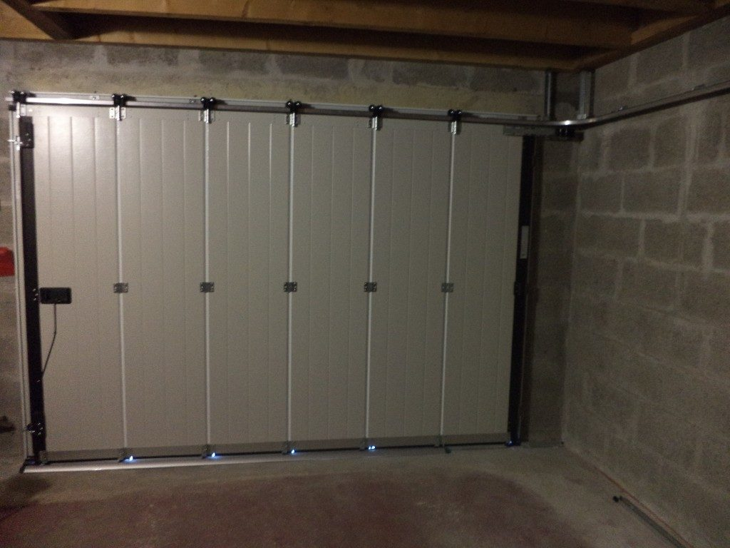 Quel type de porte coulissante de garage choisir for Porte de garage en pvc coulissante