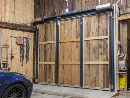 Porte de garage electrique pliante en bois
