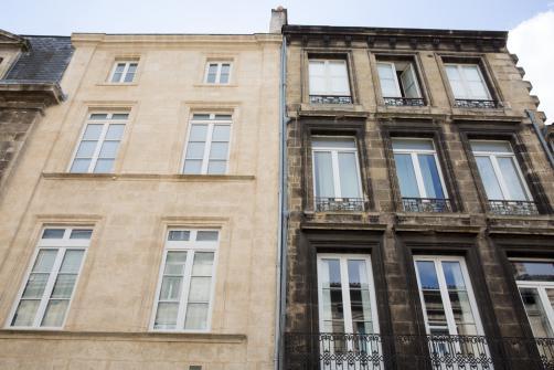 Remise en etat d'une facade en pierre - avant et apres