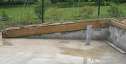 Arase du mur en bloc à bancher